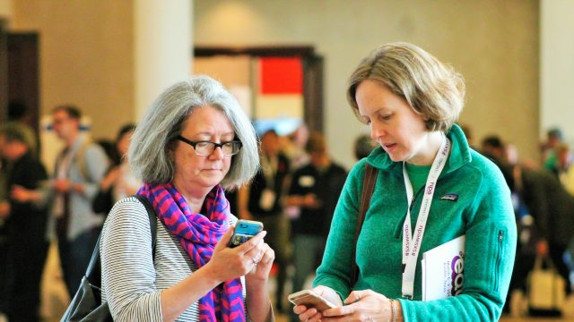 SXSW EDU 2017 attendees checking the mobile app. Photo by Nicole Burton.