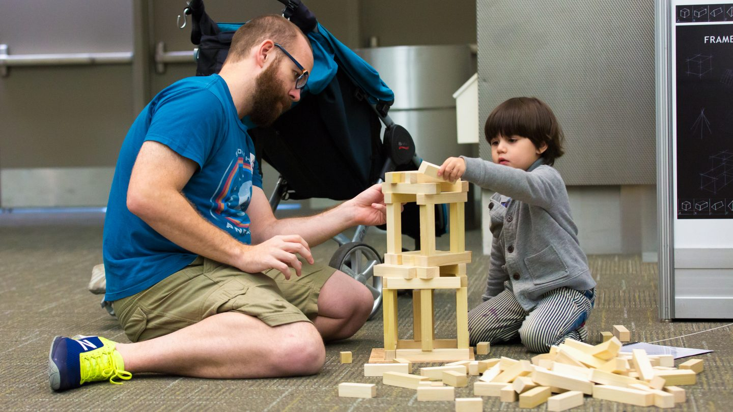 SXSW EDU 2017 Playground photo of dad and son playing with blocks.