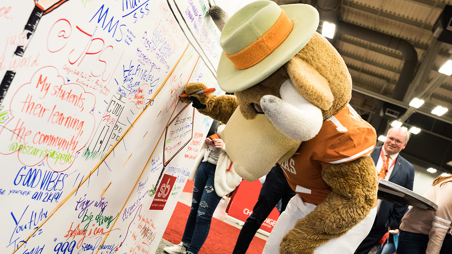 UT Mascot Signs the Coloring Wall at the SXSW EDU 2019 Playground. Photo by Bob Johnson.