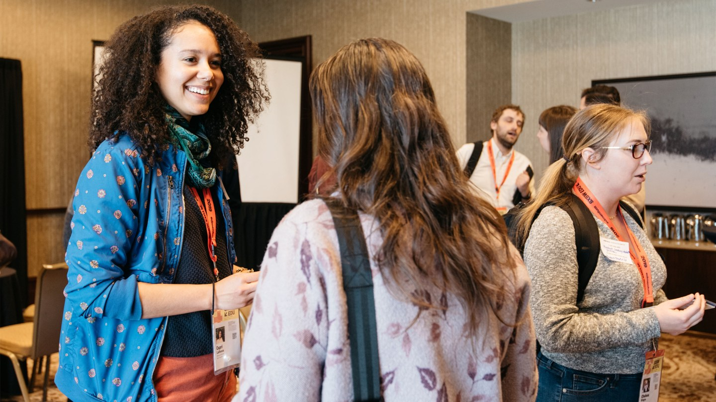 Attendees making a networking connection at SXSW EDU 2019.