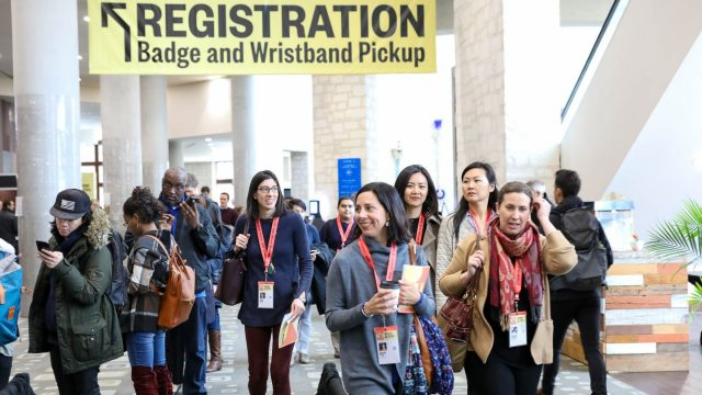 SXSW EDU 2019 Attendees picking up registration badge.