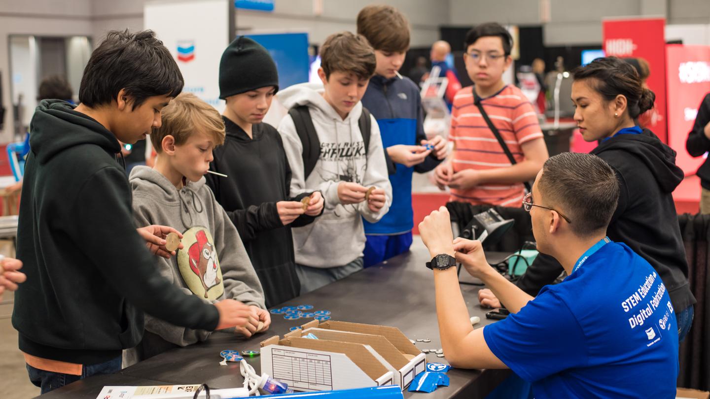 Students engaged at SXSW EDU expo.